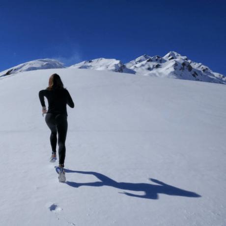 Running up a snowy hill